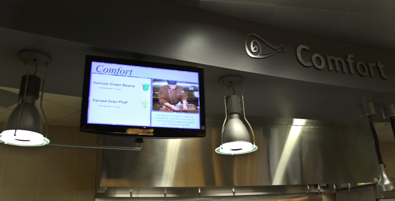 Photo by Ryan McCaughtry. This screen in the Comfort Station of Anderson Commons is one of the many screens throughout the Knutson Campus Center. The TVs provide information about the nutritional value of what is being served.