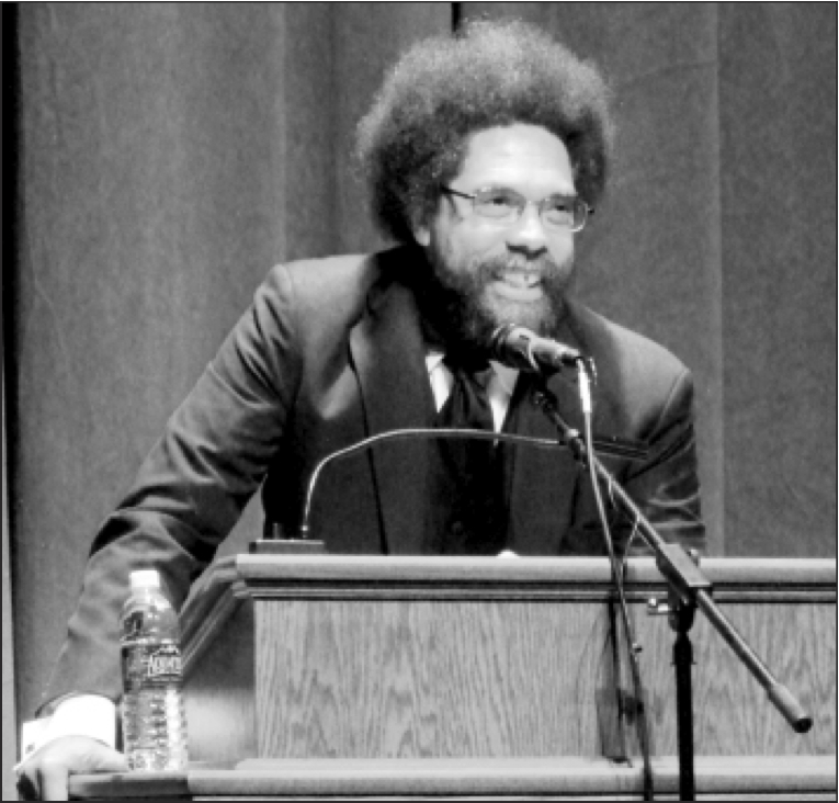 Photo by Marisa Jackels. Cornel West engages a crowded audience at Minnesota State University  Moorhead. West challenged the audience to love one another.