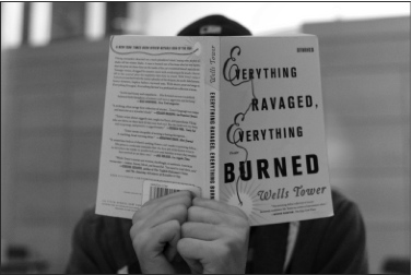 """Photo by Zach Forstrom. Collections of short stories, such as """"Everything Ravaged, Everything Burned"""" by Wells Towers, provide an ideal solution for students who find they don't have enough time to devote to reading an entire novel for pleasure, but still hope to engage in some relaxing reading during their spare time."""