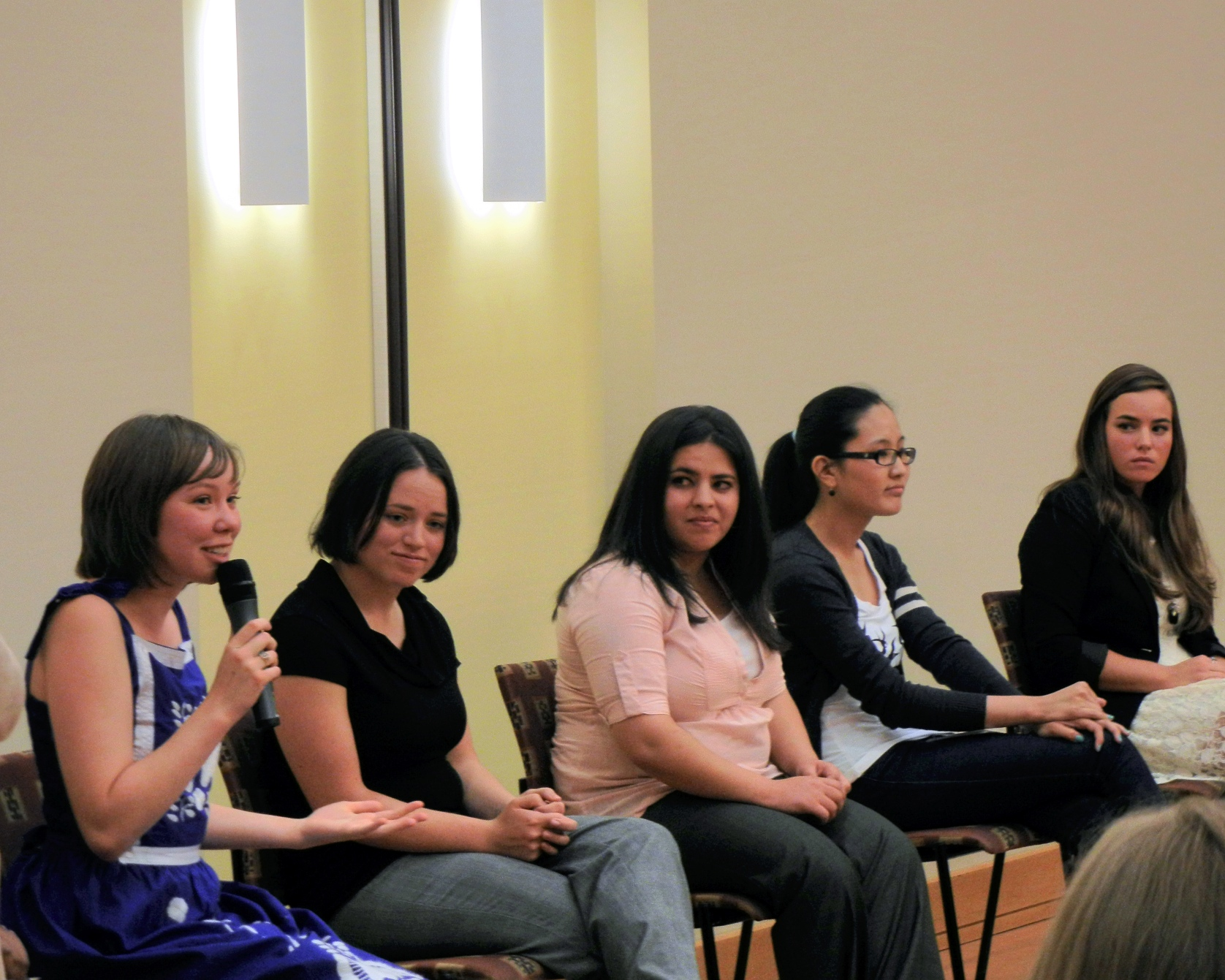 Photo by Marisa Jackels. Senior Elise Tweten speaks at the Women's Interfaith Panel while Kelsy Johnson, Siham Amedy, Sonam Deyki and Kristi Del Vecchio listen.
