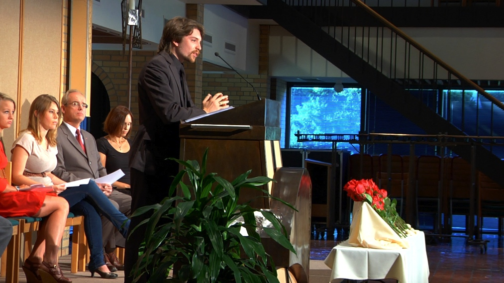 Photo by Brandon King. Bjorn Kvernstuern speaks at a memorial service during chapel on Sep. 7.