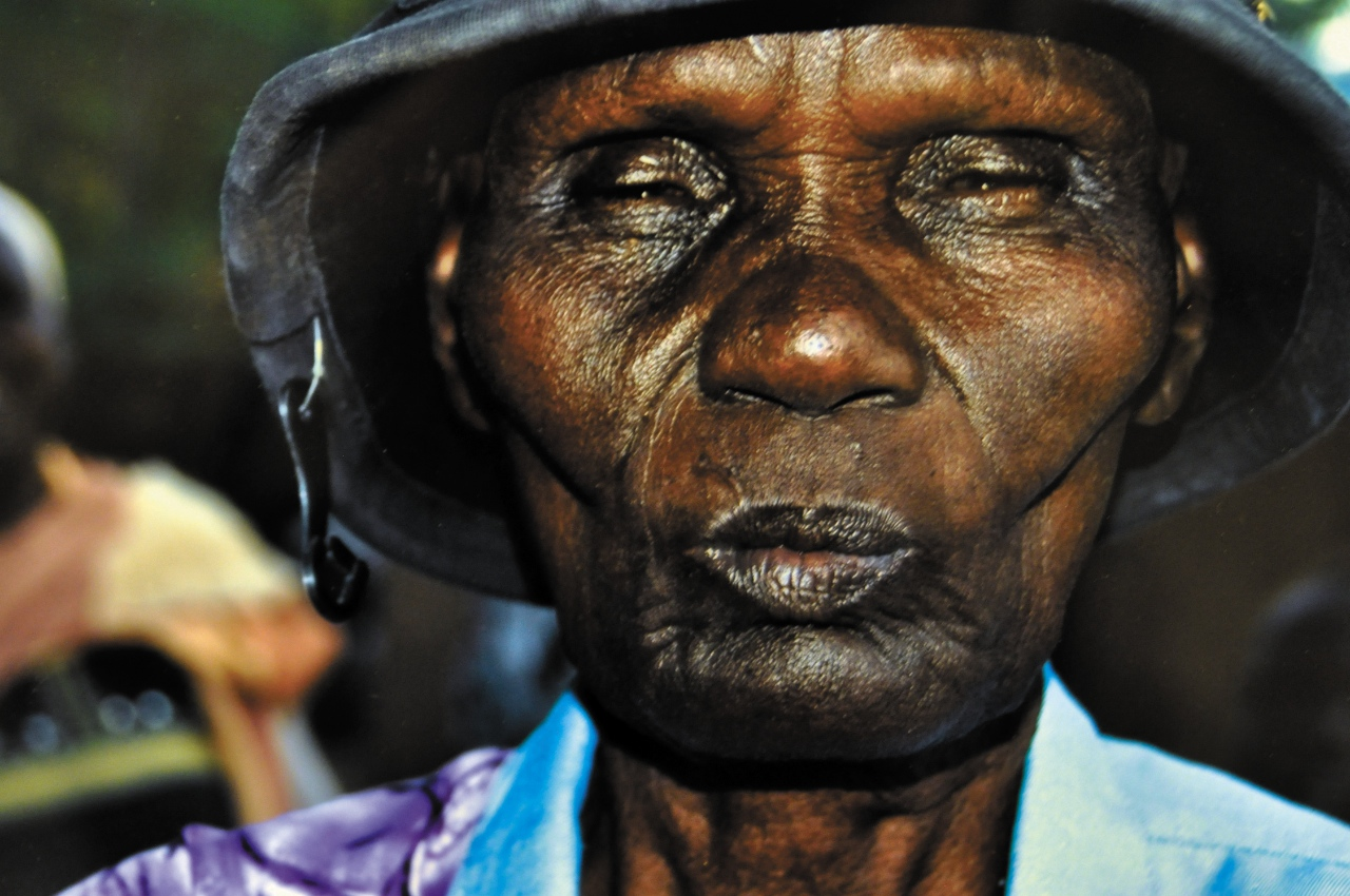 "Photo by Kyle Thiele. This photo, titled ""Woman with Hat & Hook"" is one of many from the ""African Soul, American Heart"" exhibit currently beig shown at the Hjemkomst Center in Moorhead. The photos were taken by Debra Dawson, a Fargo native who traveled to Duk Payuel in South Sudan."