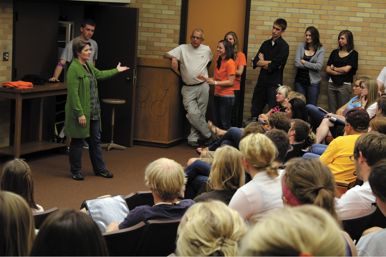 Photo by Brandon King. Patti Sue Arnold, founder of an orphanage in Shell, Ecuador, tells a crowd of Concordia College students about her mission and the work of recent Cobber volunteers. A group of up to 28 students will travel to Ecuador over spring break.