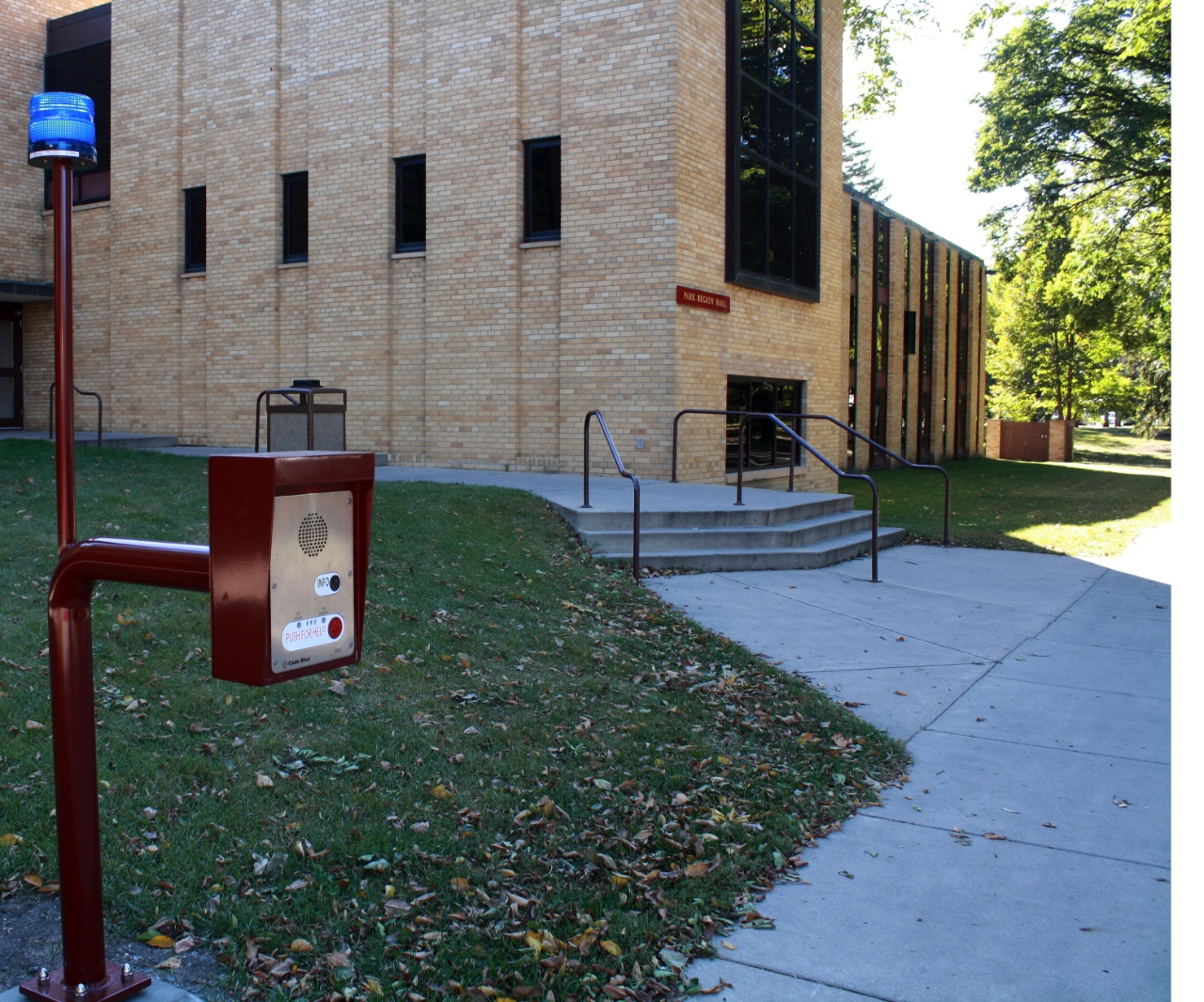 Photo by Rachel Webster. This new Code Blue emergency box is located in front of Park Region Hall. Passerby's can push the red button for emergency help.