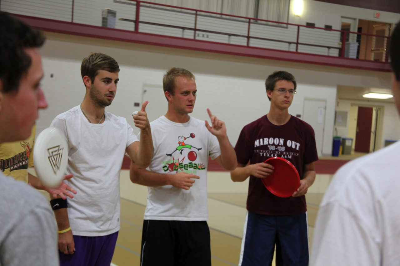 Photo by Riah Roe. Captain of the Ultimate Frisbee team, Grant Erickson, talks with team members before practice.