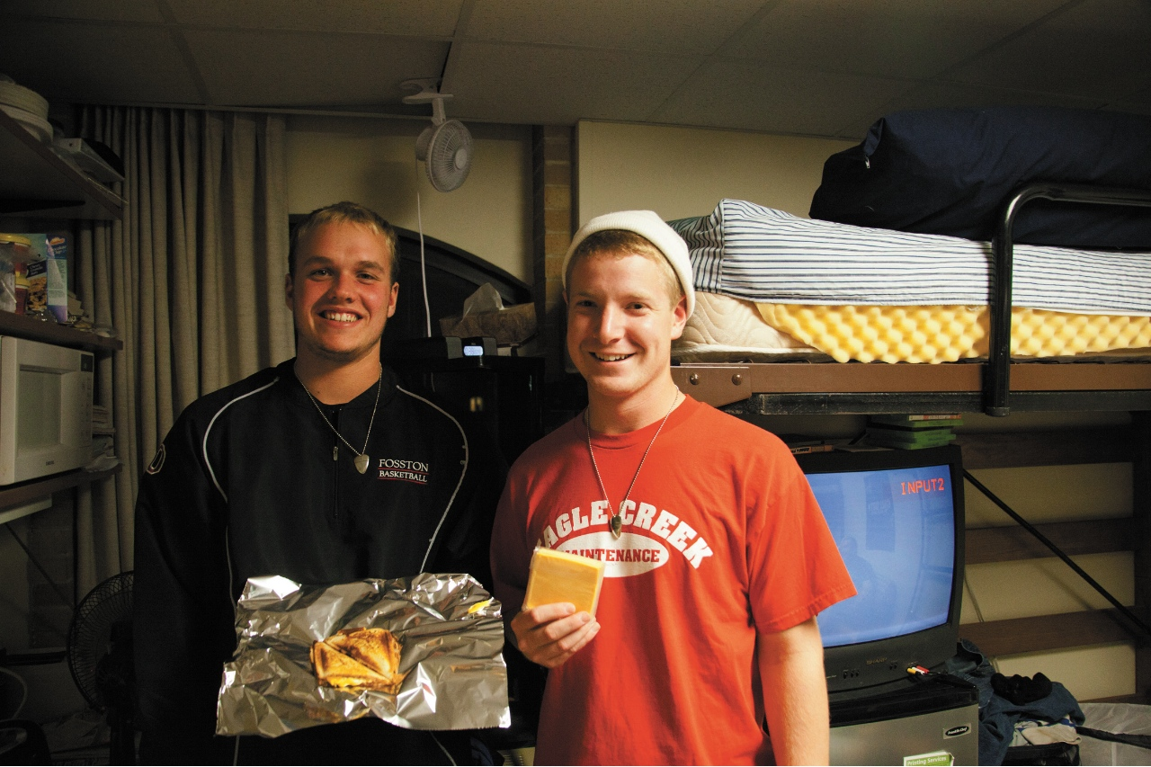 Photo by Ryan McCaughtry. Freshman roommantes Mitch Fades and Ryan Paulson show off their product, a grilled cheese sandwich. The two sell and deliver to East Complex residents.