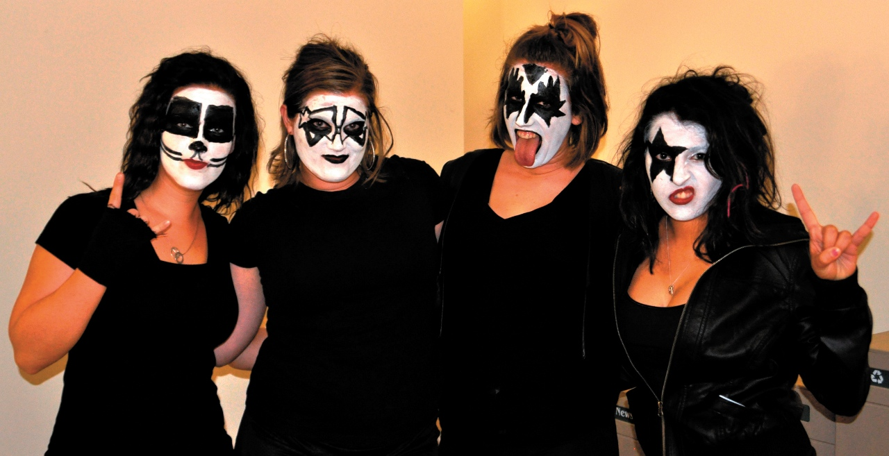 Photo by Kyle Thiele. Juniors Nikita Welder, Stephanie Wetter, Lauren Monteforte, and Danne Verghis show off their group costume as the band Kiss at the Concordia Halloween Bash Oct. 29.
