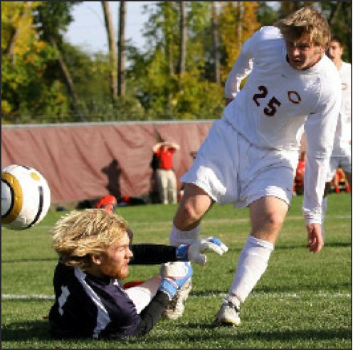 Photo from Go Cobber Blog. Sophomore Kristian Reiersgord assists the team in a play against St. Mary's.