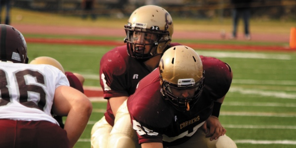 Photo by Rachel Torgerson. Quarterback Michael Dunham leads a play against Bethel this past weekend.