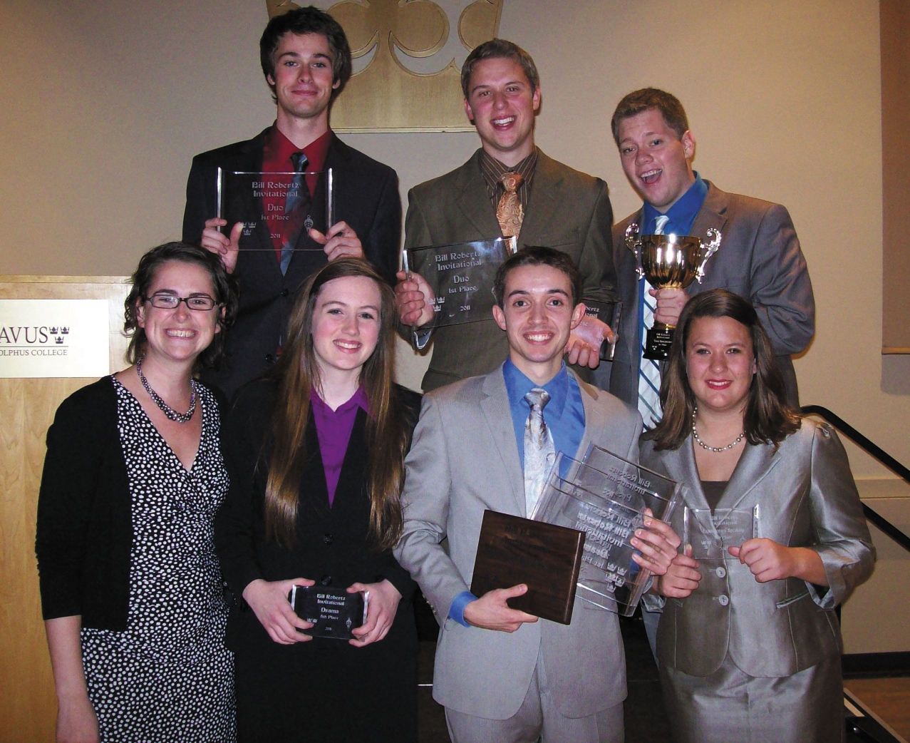 Submitted Photo. Members of the forensics team show off their awards after their competition at Minnesota State University - Mankato and Gustavus Adolphus College on Oct. 16. The speech team took first place.