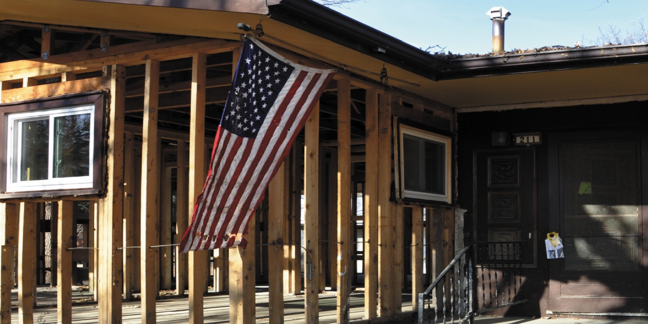 Photo submitted by Stephanie Sailer. An America flag sways in front of a gutted house in Minot after the flood of 2011. The Pay-It-Forward event hopes to raise money for the flood's victims.
