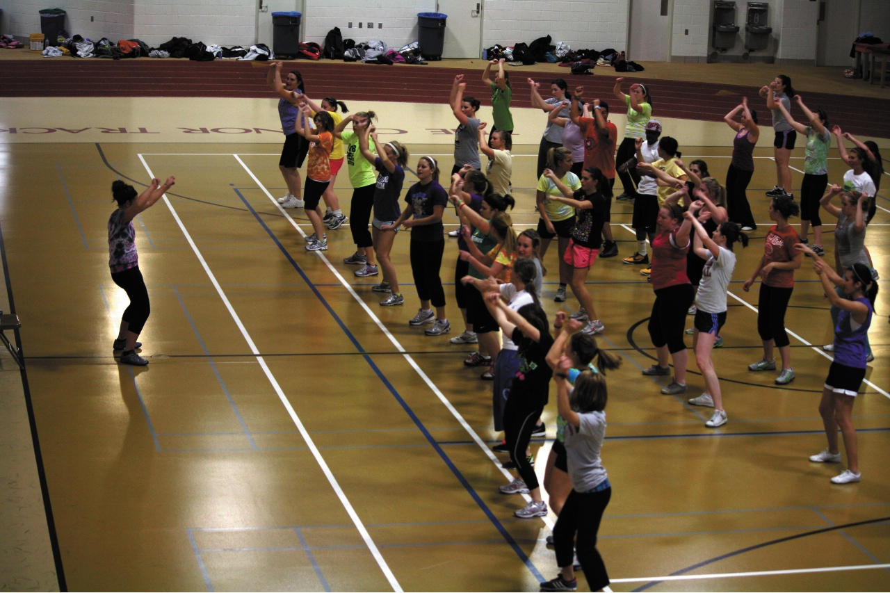 Photo by Rachel Torgerson. A group of people meet in Olson Forum to practice Zumba, a fun, dance-filled workout routine. Classes are held Tuesdays at 7:15pm and Wednesdays at 9:15 each week.