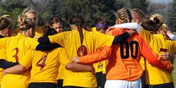 Photo by GoCobbers.com. Concordia's Women's Soccer team huddle during the Sweet 16 at the Division III National tournament.