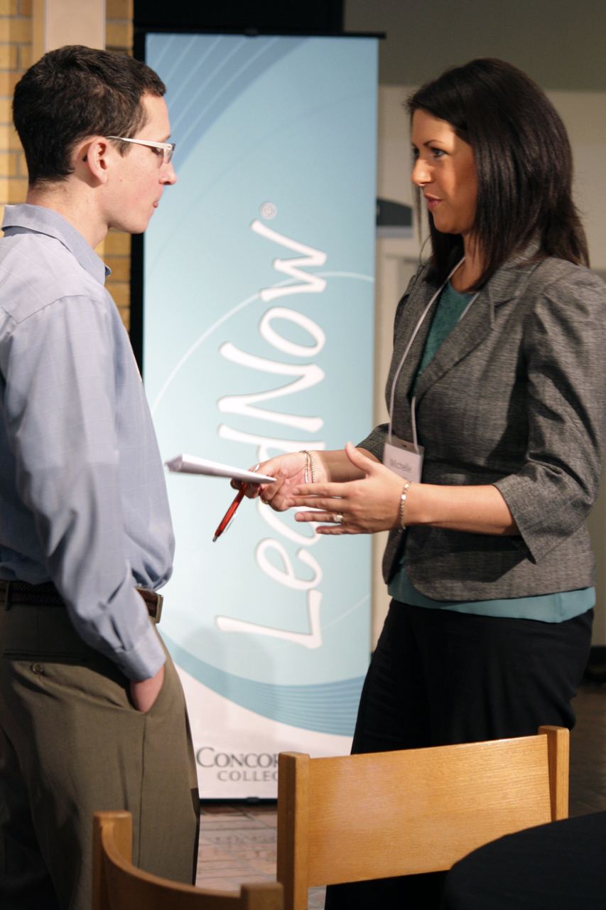 Photo by Rachel Torgerson. Michelle Killoran '01, VP of Finance for Scheels, talks to a student during the Fuel the Fire conference for LeadNow on Jan. 21.
