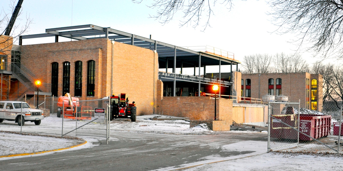 Photo by Olivia Gear. Fresh snow covers the construction site for the Offutt School of Business. The school recently announced the addition of a new auditorium, which will open with the school of business this fall.