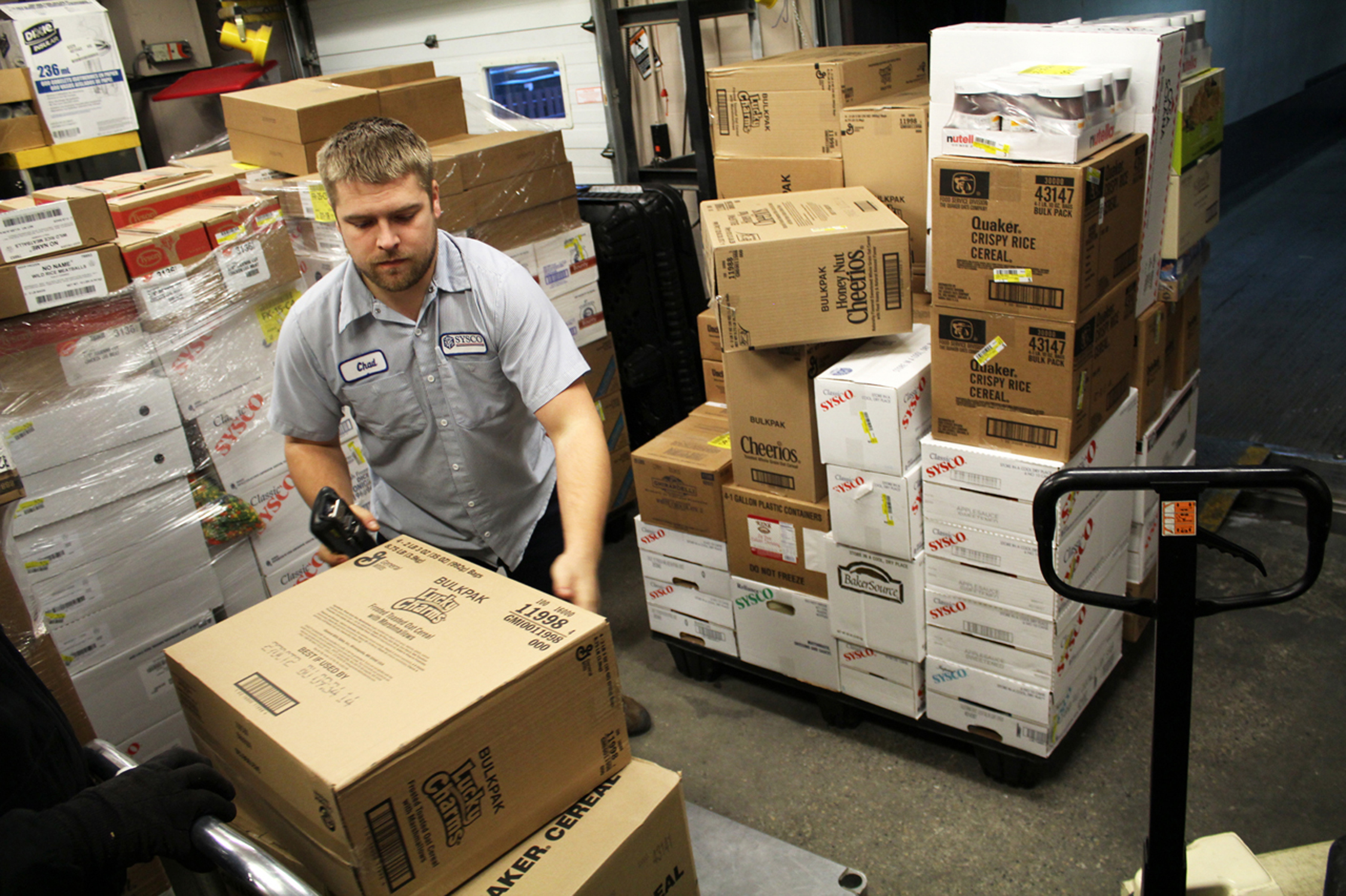 Photo by Brandon King. Chad Ouellette unloads food from Sysco. Dining Services signed on with Sysco as a new distributor August 1st.