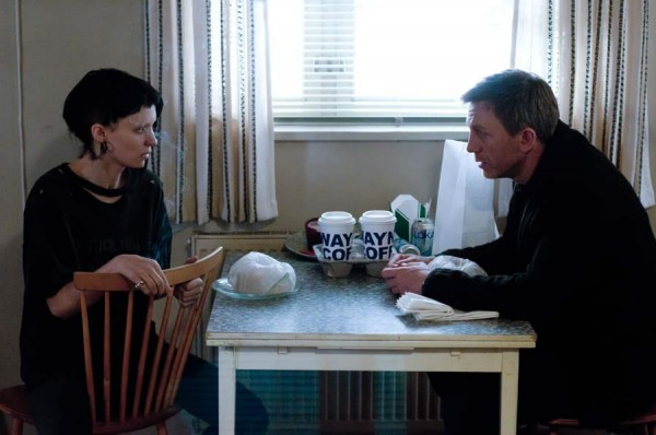 "Photo courtesy of BoomTron.com. Lisbeth Salander (Rooney Mara) and Mikael Blomkvist (Daniel Craig) investigate and sift through many documents to try to solve a 40-year-old murder in a scene from ""The Girl with the Dragon Tattoo"" directed by David Fincher."