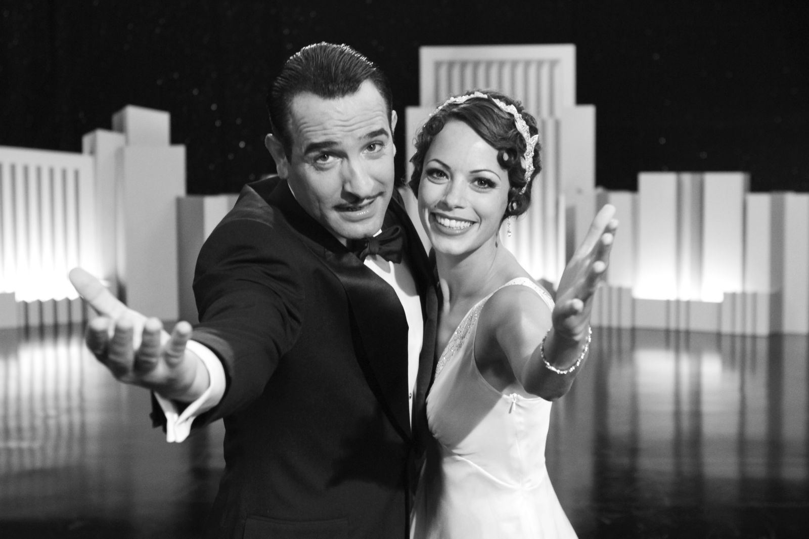 "Photo from AllMoviePhoto.com. George Valentin (Jean Dujardin) and Peppy Miller (Berenice Bejo) act out a scene from Michel Hazanavicius's film ""The Artist."""