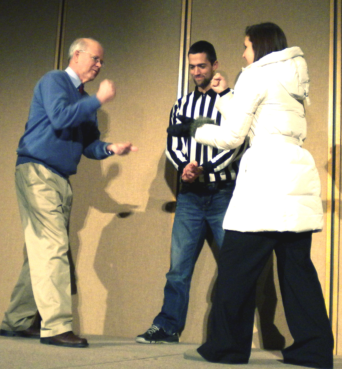 Photo by Jamie Telander. Kendal Black of the Office of STudent Success and Retention Services faces off against President Craft in the Rock Paper Scissors competition while Senior Caleb Giesen referees.