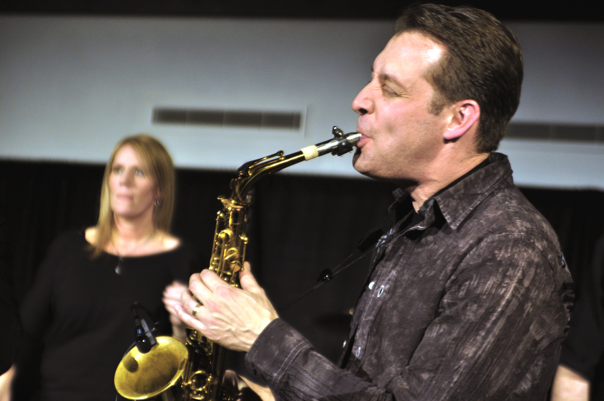 Photo by Rachel Torgerson. Russ Peterson, who plays alto sax in the band Post Traumatic Funk Syndrome by night, is also a professor in Hvidsten Hall of Music by day. PTFS rocked the Centrum Friday Jan. 27 with songs by Chicago, The Blue Brothers, Stevie Wonder, and other musical artists.