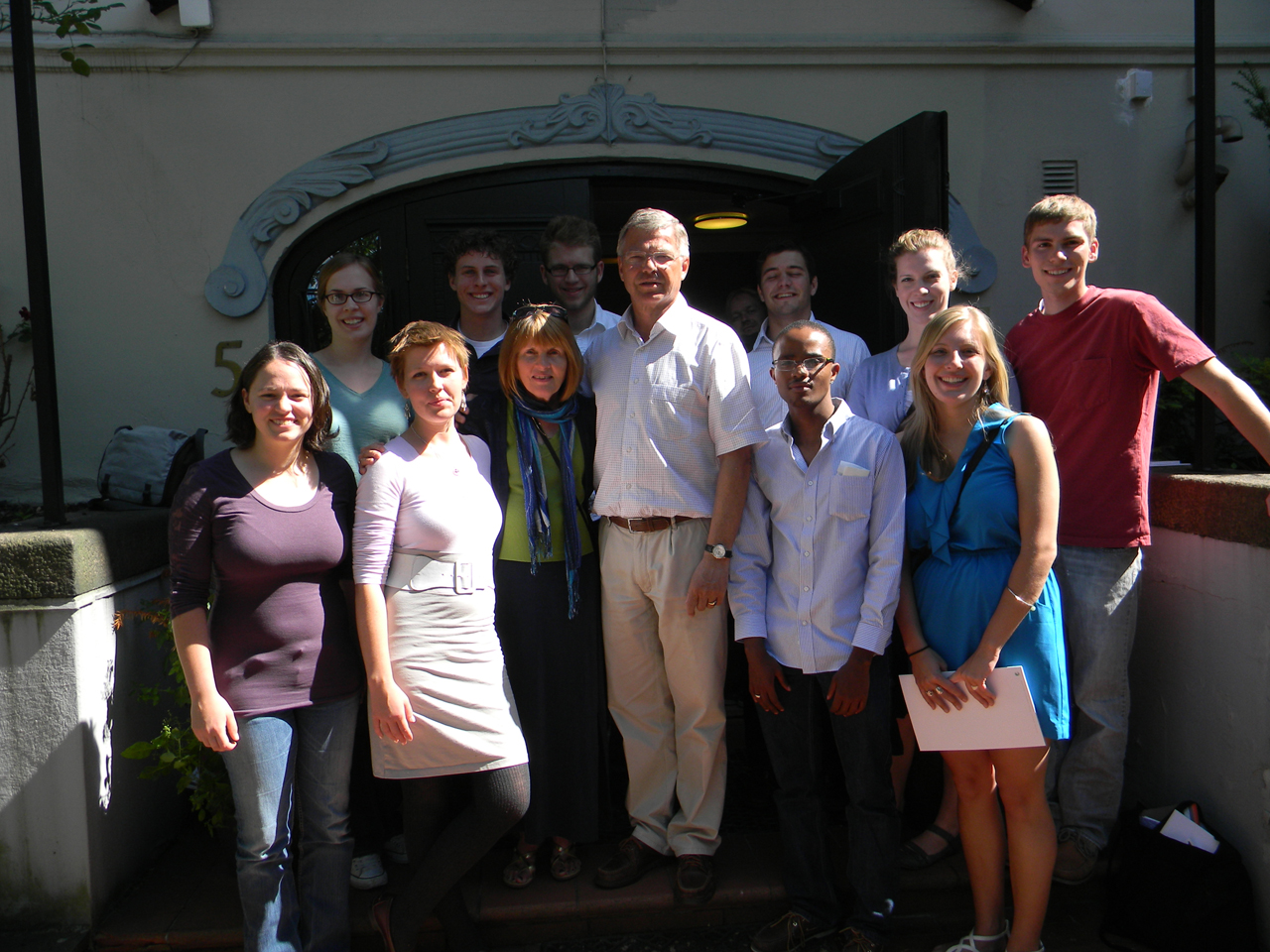 Photo Submitted. Nobel Peace Prize Forum scholars and friends pose with Kjell Bondevik, former prime minister of Norway, outside of the Oslo Center for Peace and Human Rights. This year, the forum will be held i its new permanent home, Augsburg College in Minneapolis.