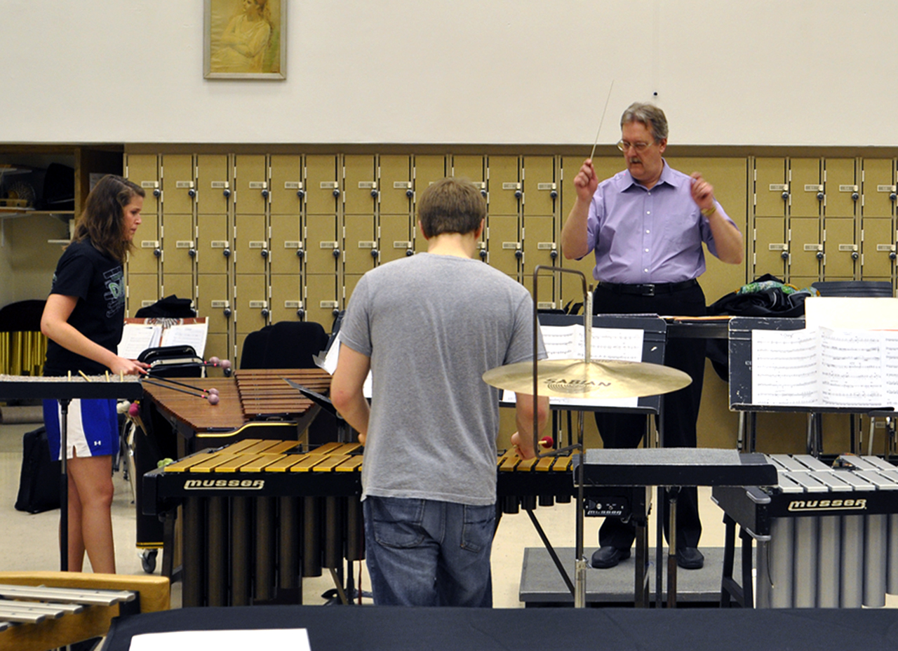"Photo by Lana Gyamera. Jenna Bakken and Mitchell Carlstom, both members of the Concordia Percussion Ensemble, practice with Dr. David Eyler, for a piece entitled ""Yurikago,"" a Japanese folk song that we be performed during the concert to end the Day of Percussion March 31."
