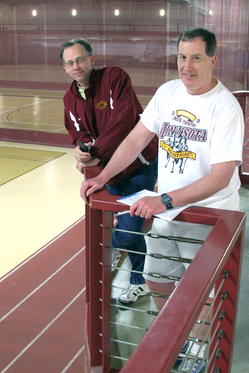 Photo by Kaia Miller. Coaches Garrick Larson (left) and Marv Roeske (right) form a great duo for the Men's and Women's Track and Field teams.