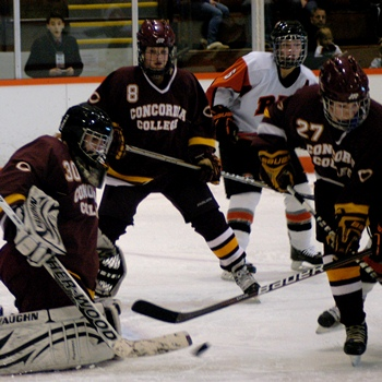 Photo by GoCobbersBlog. Freshman Cobbers Rebecca Hendrickson, Madison Gendreau and Libby Fransdal play against the #1 ranked RIT women's hockey team at the NCAA Quarterfinals.