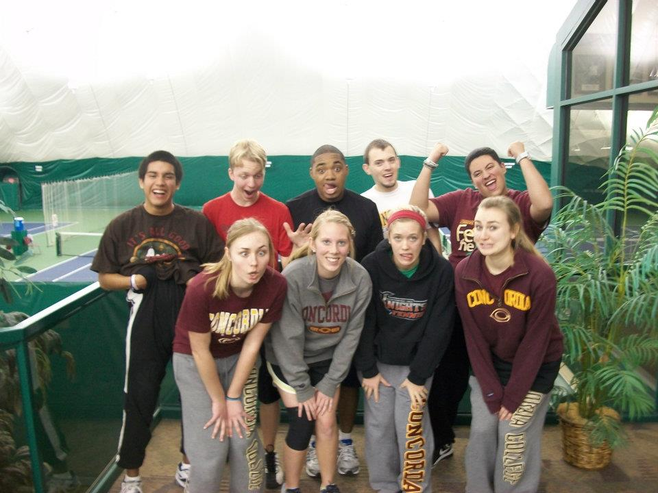 Photo from the Concordia Tennis Club Facebook Group. The Concordia Tennis Club gathers by the courts at the Gustavus Invite.