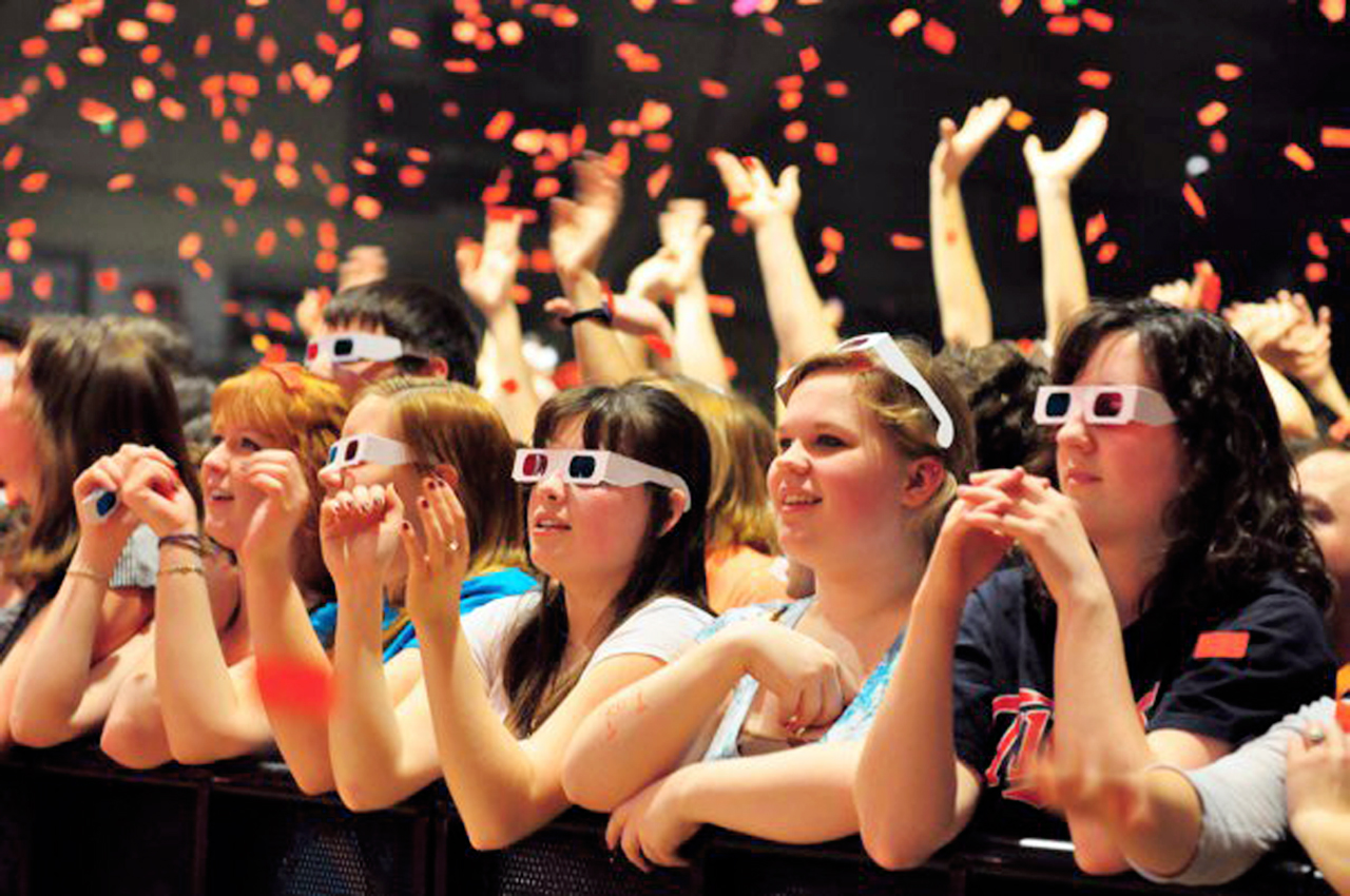 Photo submitted by Campus Entertainment Commission. Emily Hiestand, Krista Gilman, Katie Twedell, Emily Nelson and Laura Jean Kuisle wore 3D glasses for part of OKGO's performance at Cornstock last year in Memorial Auditorium. This year's headliner, Atmosphere, will bring a hip-hop vibe to campus.