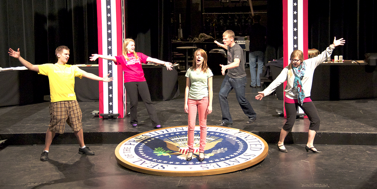 "Photo by AJ Eckberg. Cast members Ted Coonradt, Jacqui Backer, Meghan Olson, Ryan Modahl and Hannah Amundson rehearse choreography for the production of ""44 Plays for 44 Presidents."""
