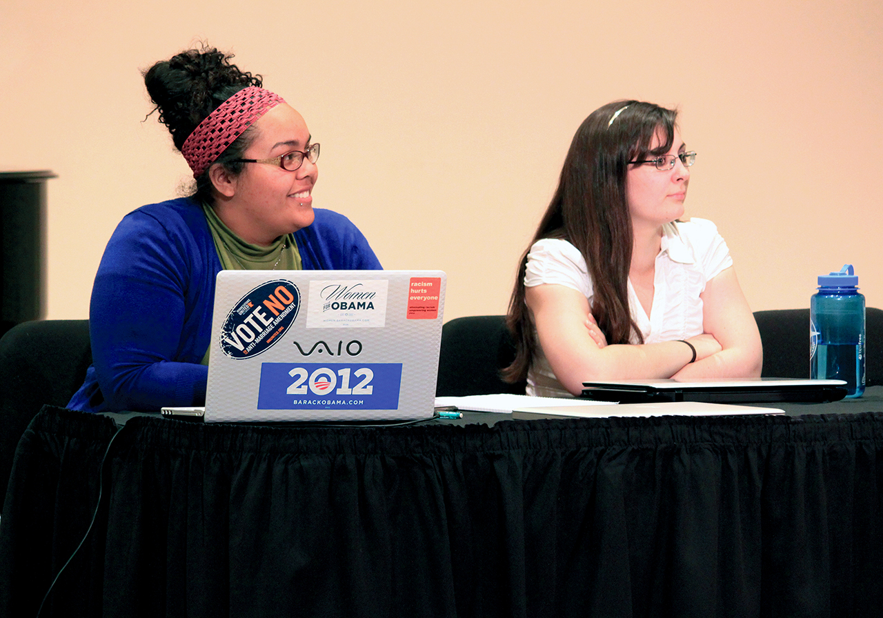 "Photo by Mary Henning. Courtney Gasner-White (left) and Lucia Martin (right) debate during their concurrent session titled ""Debating Genocide."""