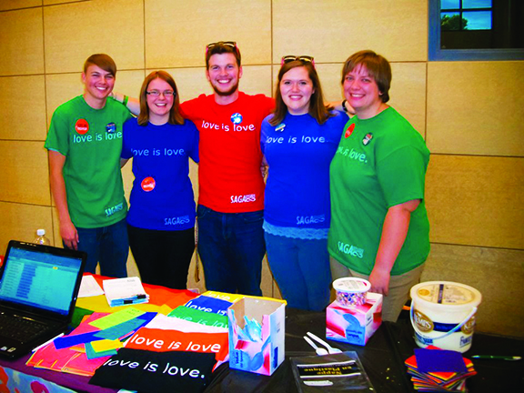 "Jeff Miller, Geneva Nemzek, Colin Sullivan, Heather Hurner and Megan Garry wear their ""love is love"" t-shirts."