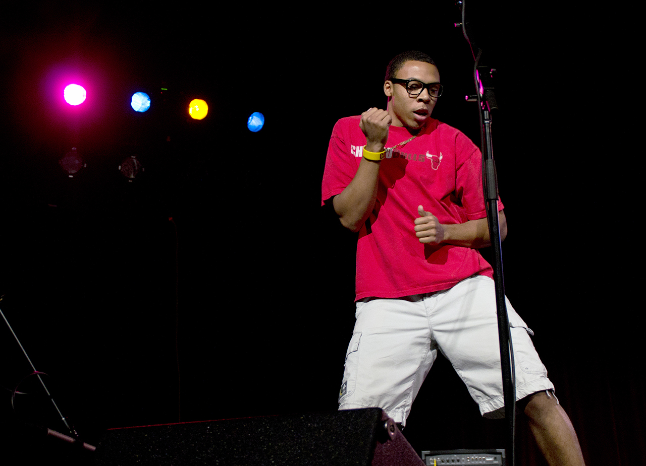 Mike Wilson, BSU president, dances on stage during Family Weekend Showcase.