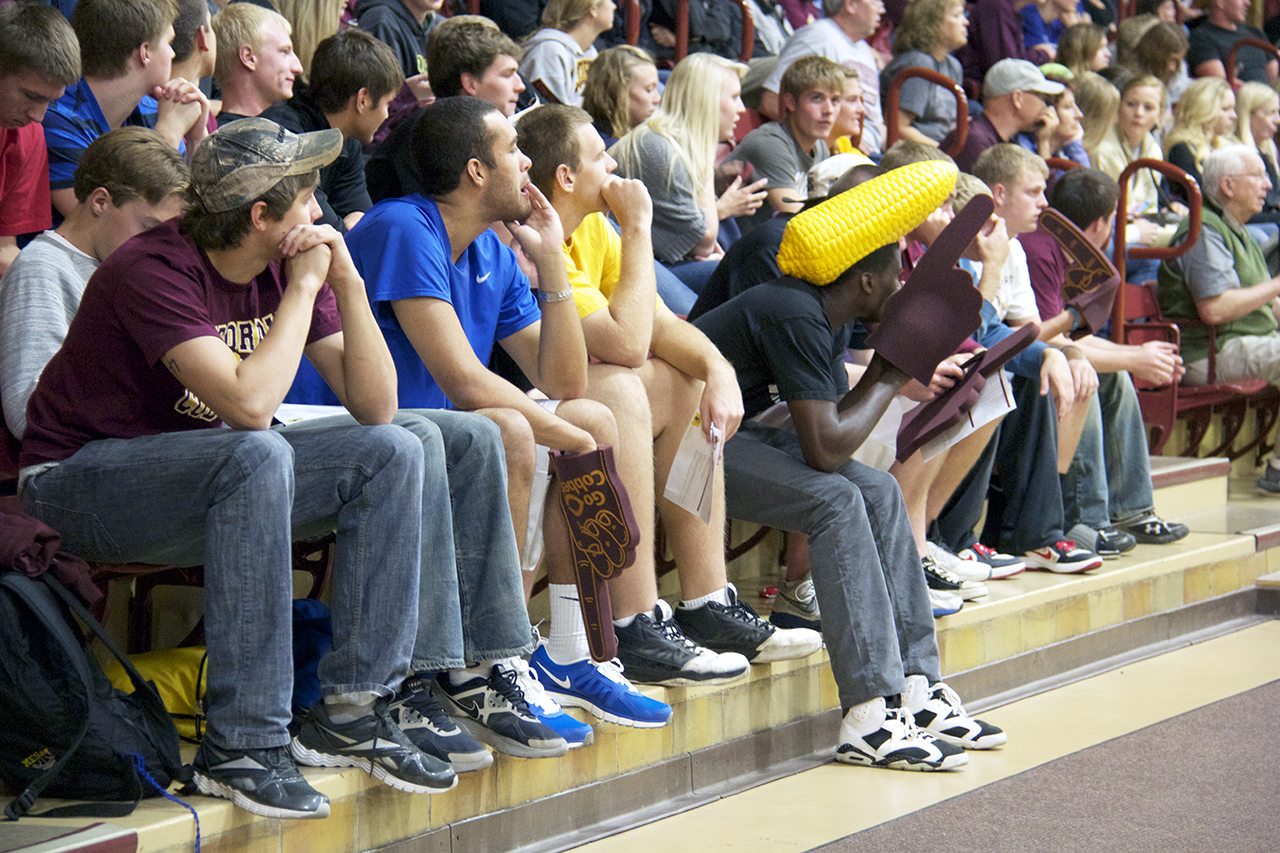 "Photo by Jamie Telander. Concordia students fill the stands at a volleyball game. Athletic Director Rich Glas is partnering with the Marketing Club to create ""Cob Mob"", a student fan group that will hopefully keep sports spectators coming."