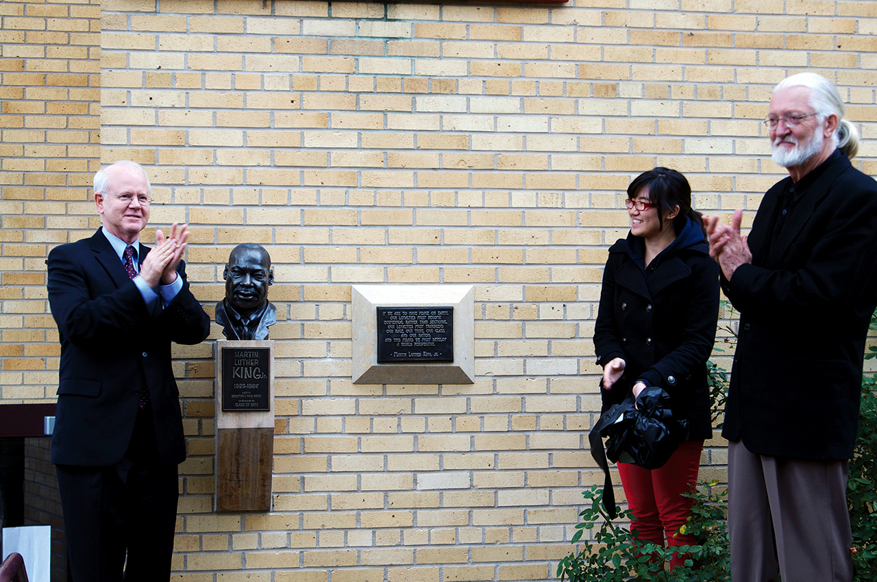Photo by Melisa Barish. President William Craft, Amy Tran and artist J. Paul Nesse surrounding the new bust and plaque of Martin Luther King Jr.
