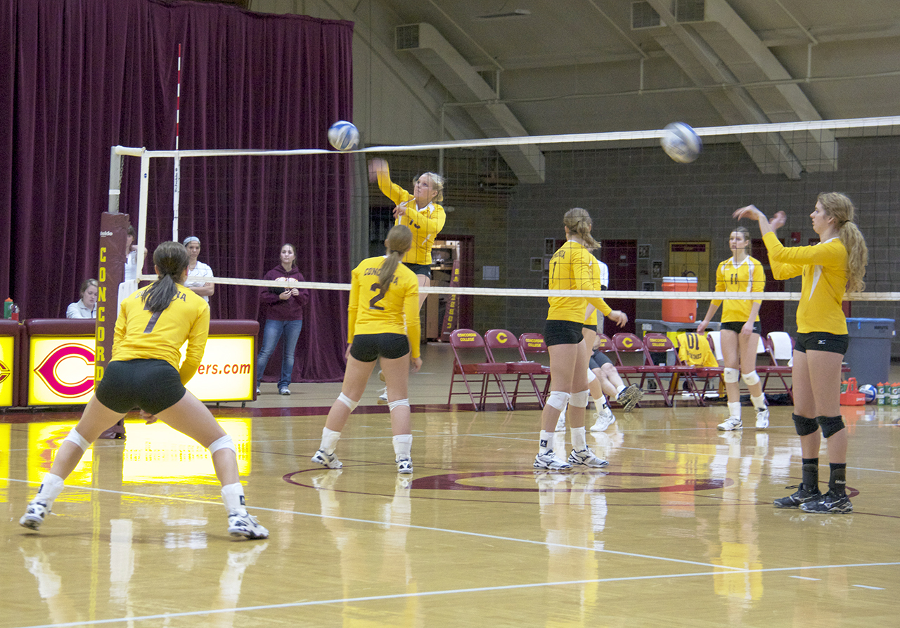 Photo by Jamie Telander. The volleyball team warms up. The women would not be playing Division III volleyball if not for Title IX, an education amendment that passed 40 years ago.