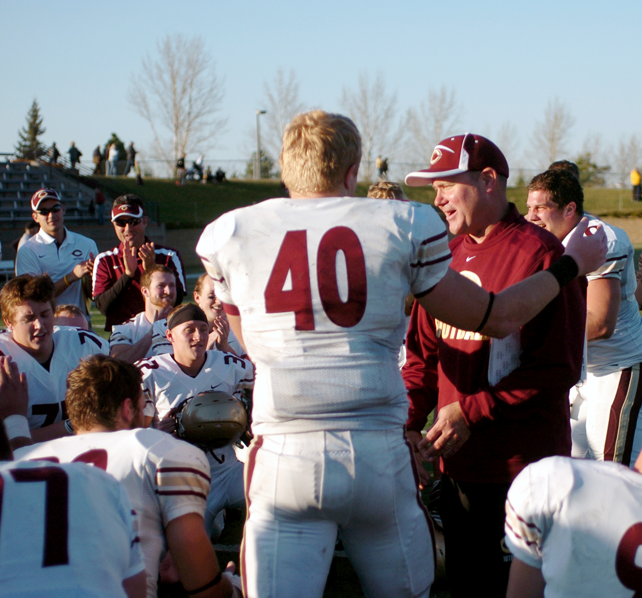 Submitted photo. Senior fullback Brett Baune and Head Coach Terry Horan embrace after Concordia's win over Gustavus on November 9. Baune broke Horan's record for most career touchdowns by a Cobber,a record that stood for 24 years.