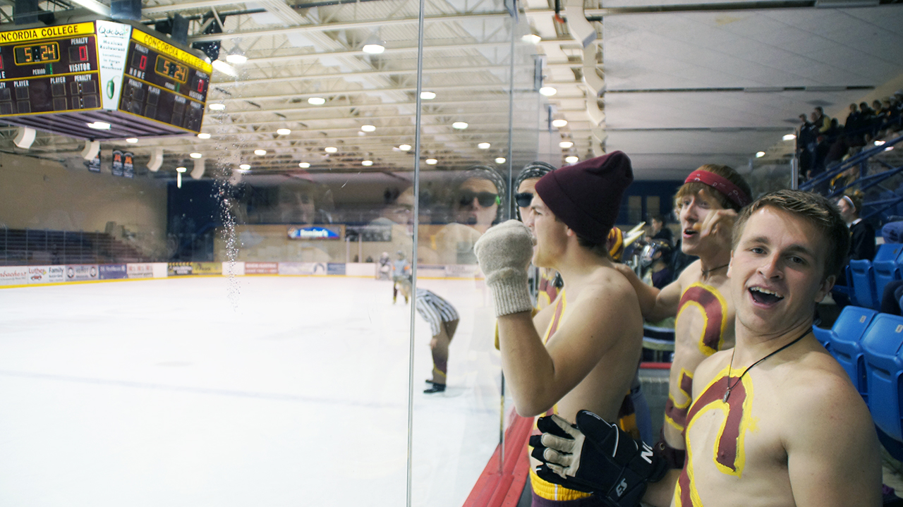 Cobber Nation Vice President Kristian Erickson cheers at a hockey game with other members of the fan group. Cobber Nation will be in attendance at hockey games this year and hopes to attract a larger fan base to the events.