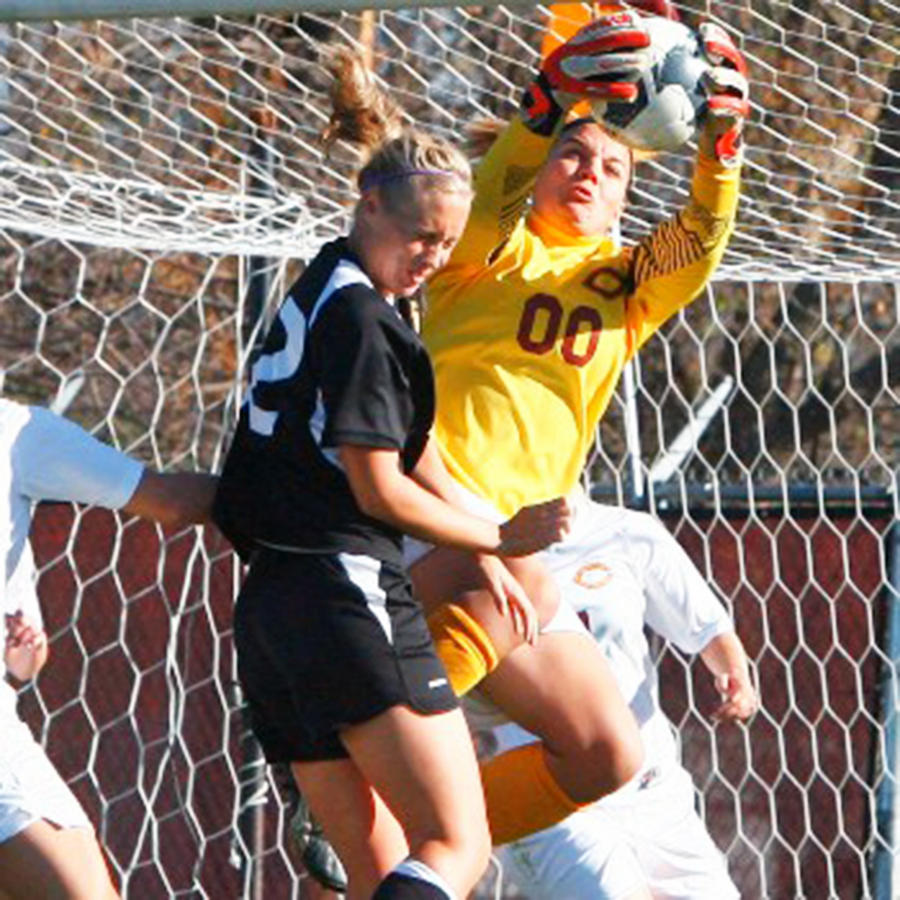 Goalie Ali Nelson, who got her 38th shutout in a game against St. Olaf last week, makes a save for the Cobber women's soccer team. The team won the MIAC championship  title  this past Saturday.