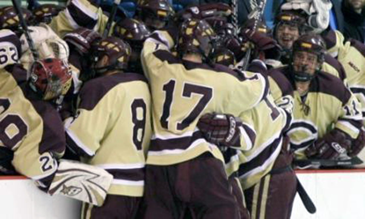 Submitted photo. The men's hockey team celebrates during a recent game. Team members say game rituals are part of the celebration, and keep the players pumped up for competition.