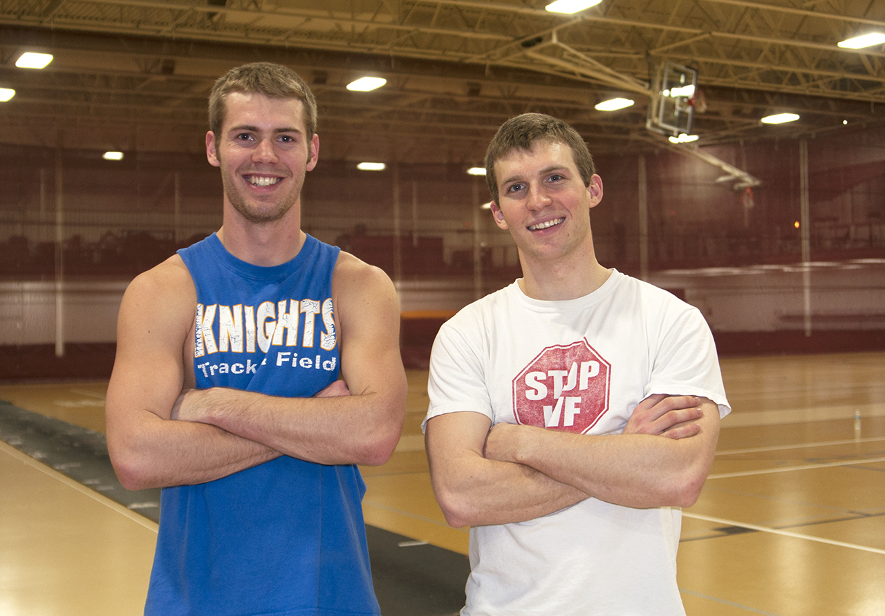 Photo by Ali Everts. Concordia track and field pole vaulters Erik Olson and Levi Bachmeier at a recent practice. Olson broke a school height record that had stood for 30 years. Olson's new record is 15-05.25.