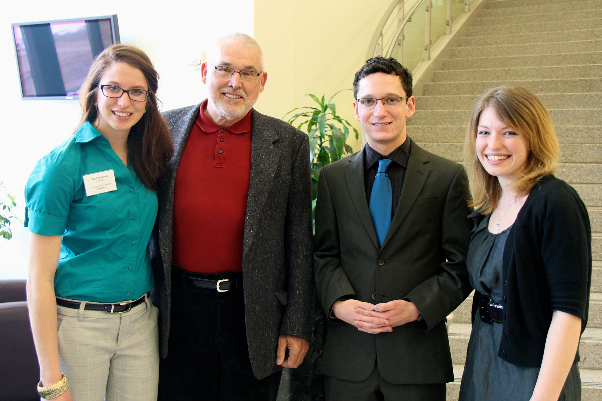 Photo by Gia Rassier. Mike Doyle returned to campus to recognize the third recipient of the President Pamela M. Jolicoeur Endowed Memorial Scholarship, Katharine Spencer (right) at the Celebration of Student Scholarhip. Also pictured: Steph Barnhart and Matthew Gantz, past winners of the award.