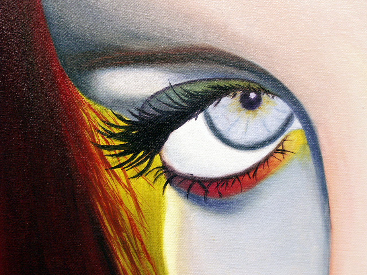 Photo by Beth Meemken. Senior artist Michaela Chorn's self portrait with colorful eyes and oil on canvas.
