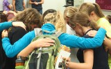 Cru members pray together at their first meeting of the year. Cru members say the organization will not seek official recognition this year. Photo by Morgan Schlief.