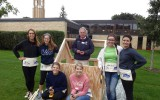 A group of LDS members help build playhouses for Habitat for Humanity's Playhouse Project. Submitted photo.