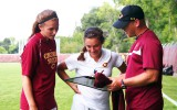 Coach Roos goes over game strategy with two of his players. Submitted photo.