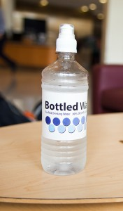 Sustainability, Bottled Water on Table WEB - Chase Body