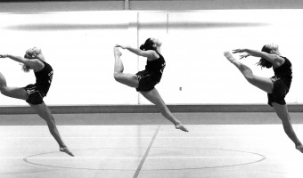 Abby Berglund, Shannon Flanery and Amy Crane practice their firebird technique during a Tuesday night practice in Olson Forum. Photo by Morgan Schleif.