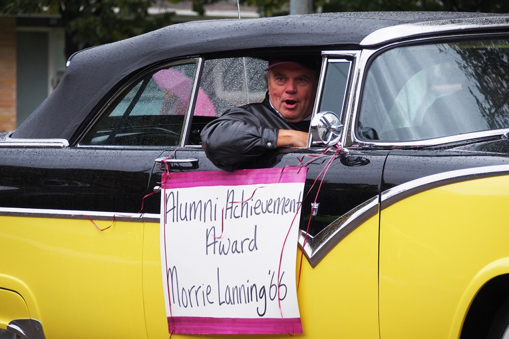 Former dean of students and current member of the Minnesota House of Representatives Morrie Lanning rides alone in the parade. Photo by Chase Body.